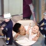 Tuấn Hưng kéo con trai trên vali ở sân bay