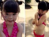 Con gái Thúy Nga diện áo tắm khoe bụng tròn xoe