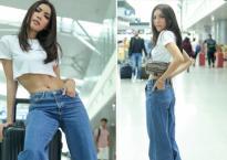 Minh Tú tích cực lăng xê quần ống loe thập niên 90 tại sân bay đi Thái Lan