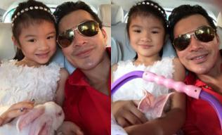 Con gái Trần Bảo Sơn ôm thỏ cực yêu khi đi chơi cùng bố