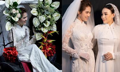 Ngọc Trinh e ấp yêu kiều trong áo dài cưới tinh khôi, ngồi xe kéo trên sàn catwalk
