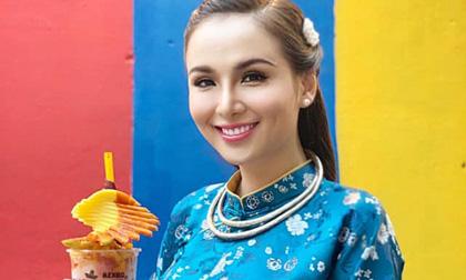 Hoa hậu Diễm Hương diện áo dài lộng lẫy nhưng gương mặt khác lạ mới là tâm điểm