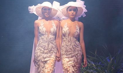 Kỳ Duyên - Minh Triệu diện váy cưới nắm tay nhau tình tứ như đôi tình nhân trên sàn diễn thời trang