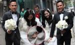 Chú rể Ngọc Thành rạng rỡ nâng váy giúp cô dâu Tâm Tít