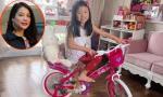 Con gái Trương Ngọc Ánh thích thú đi xe đạp