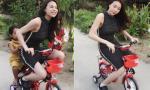 Trà Ngọc Hằng mặc váy đạp xe... ba bánh siêu 'ngầu'