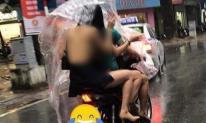 Cô gái mặc váy hở toàn bộ lưng, lộ phần nhạy cảm đi ra đường giữa trời mưa khiến dân mạng lắc đầu ngán ngẩm