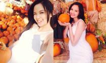 Diễm Hương khoe bụng bầu to đi chơi Halloween