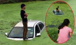 Ô tô bay ra giữa sông, lái xe đứng trên nóc chờ cứu tranh thủ tán gái làng