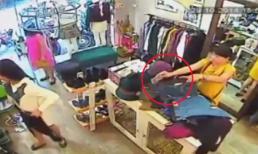 Cận cảnh nữ quái trộm iPhone 6 Plus trong shop thời trang