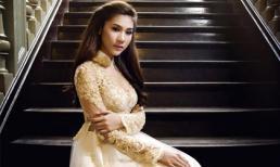Kim Dung e ấp trong áo dài Huỳnh Lợi
