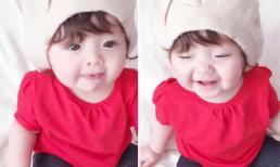 Cadie diện áo đỏ rực, cười toe toét trong ngày đầu năm mới