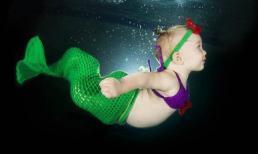 Ngộ nghĩnh trẻ thơ bơi lội dưới làn nước xanh