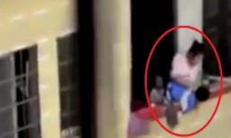 Bà mẹ treo con lủng lẳng trên tầng 7 gây phẫn nộ