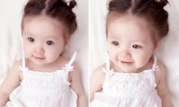 Cadie búi tóc diện váy trắng tinh như thiên thần nhỏ