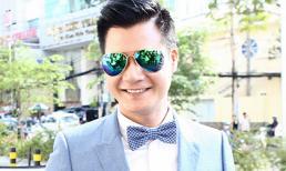 Quang Dũng đeo kính râm đi 'nhận chức' mới