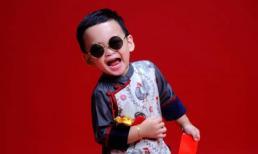 Con trai Diễm Hương đáng yêu khi diện áo dài chụp ảnh Tết