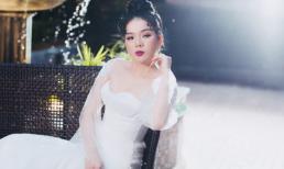 Lệ Quyên bồi hồi mặc váy cưới một mình giữa khung cảnh thơ mộng