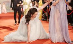 Diện chiếc váy quá dài, Nhật Kim Anh vấp ngã trên thảm đỏ LHP Quốc tế Hà Nội