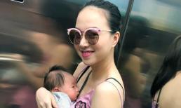 Sau một tháng sinh con, Đinh Ngọc Diệp diện áo hai dây, khoe dáng thon gọn bế con xuống phố