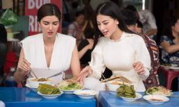 Phương Khánh duyên dáng với áo dài trắng, đưa Á hậu Miss Earth 2018 khám phá TP.HCM