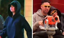 1 năm sau khi chia tay Justin Bieber, Selena Gomez bị bắt gặp tựa đầu vào vai chàng trai bí ẩn