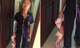 Mẹ trẻ xăm trổ túm cổ áo, xách ngược con mới sinh lủng lẳng trên tay khiến dân mạng phẫn nộ
