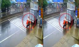 Thấy ôtô tải đang lùi, cô gái đi xe đạp điện vẫn cố thủ thi gan với tài xế