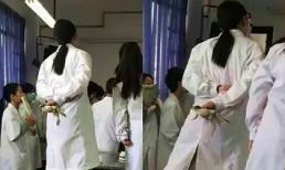 Shock trước cảnh nữ sinh trường Y bóp chặt con ếch đang còn sống trên tay, đứng lên ghế chăm chú nghe giảng thực hành mổ