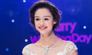 Mẫu lai Emily 13 tuổi làm cô dâu lộng lẫy bên ca sĩ Vũ Duy Khánh