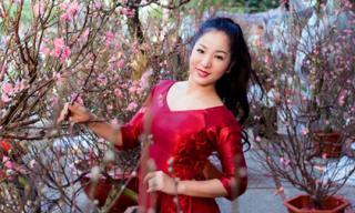 Thúy Nga diện áo dài cách tân đi chợ hoa xuân