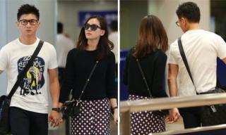 Vợ chồng Ngô Kỳ Long và Lưu Thi Thi sành điệu ở sân bay