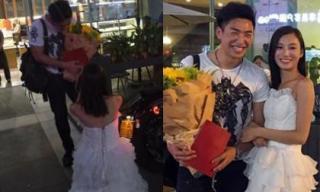 Cô gái quỳ gối giữa phố và dùng 'sổ đỏ' để cầu hôn bạn trai