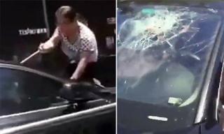 Bắt quả tang chồng chở nhân tình, vợ bất chấp đu bám đập vỡ kính xe
