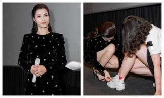 Gạt bỏ đẳng cấp ngôi sao, Đông Nhi cúi xuống buộc dây giày cho fan ngay giữa sự kiện