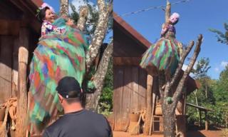 H'Hen Niê bị 'treo'... lủng lẳng trên cây cùng bộ váy đắt giá