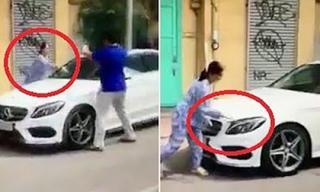 Công an đã mời người phụ nữ dùng búa đập xe Mercedes vì 'rọi đèn vào nhà là mang xui xẻo' lên trụ sở