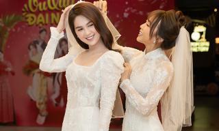 Rũ bỏ những bộ cánh lộng lẫy, Ngọc Trinh khoe dáng ngọc với áo dài trắng tinh, dắt tay 'chị em ế' Diệu Nhi đi tìm tình yêu