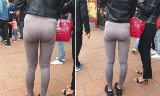 Dù mặc kín đi lễ đầu năm, nhưng cô gái vẫn gây phản cảm vì kiểu ăn mặc này
