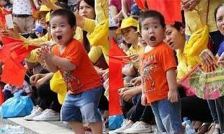 Biểu cảm đáng yêu của cậu bé xem diễu binh gây sốt