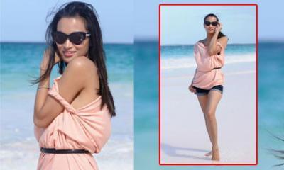 Vợ cũ Lam Trường khoe dáng gợi cảm như siêu mẫu trên biển