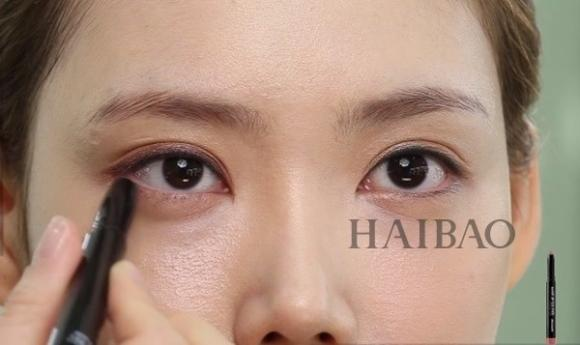 Trang điểm mắt màu cam 7